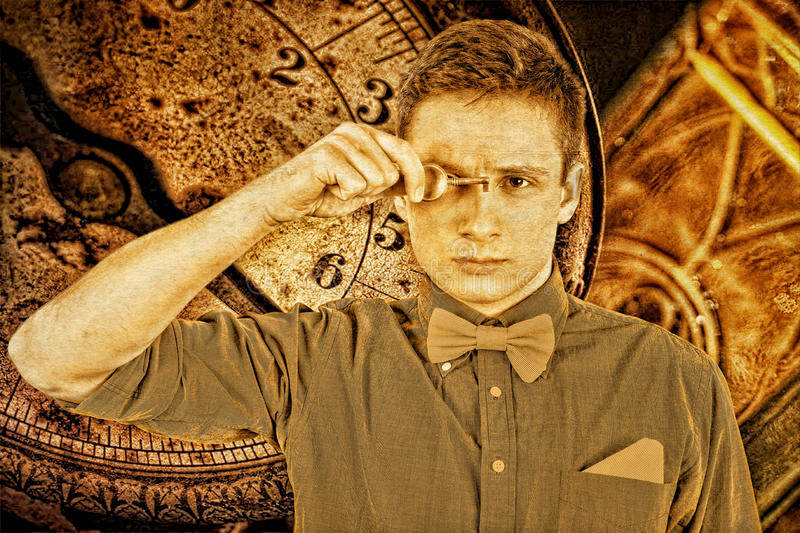 Modern prophet holds key to his eye. As a symbol of prophecies of future. The prophecy of future events Oracle with time retro background. Young serious man in royalty free stock photography