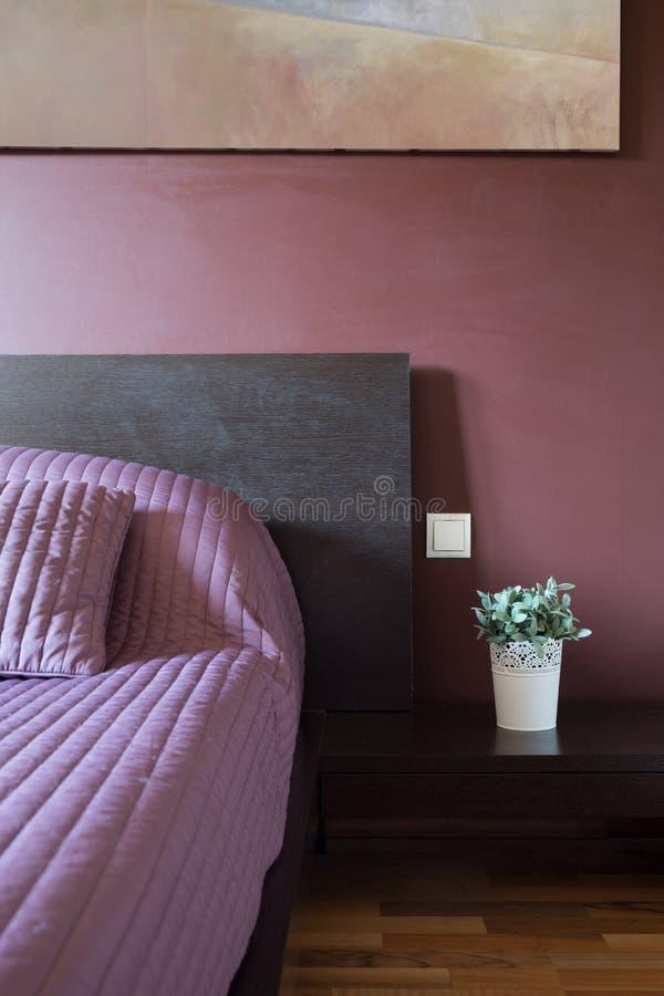 Modern purple bedroom. Interior of modern purple bedroom inside house stock photo