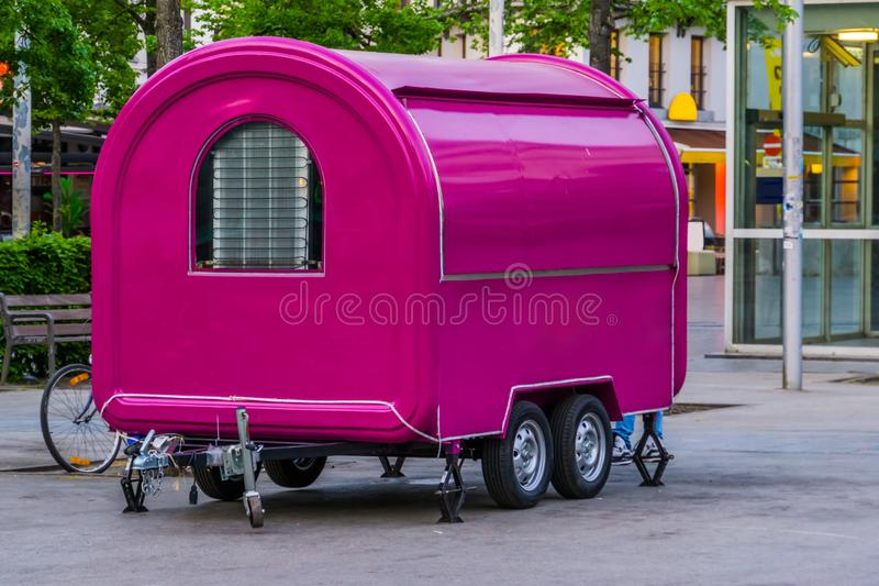 Modern purple city food store, carriage with closed shutter, Mobile store in the big city stock photography