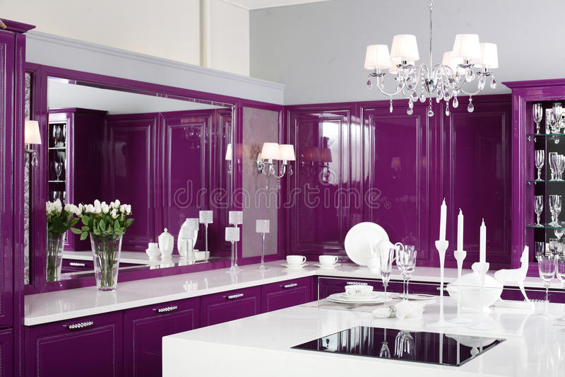 Modern Purple Kitchen With Stylish Furniture Stock Photo