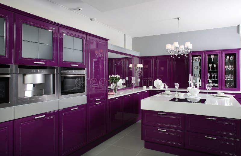 Modern purple kitchen with stylish furniture stock photos