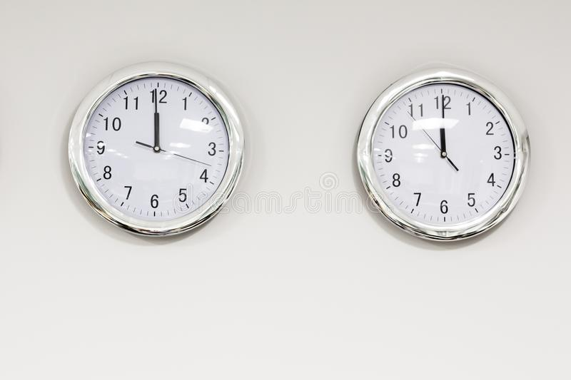 Modern quarz analog clocks on white wall in office. Horizontal orientation with text space below royalty free stock photos