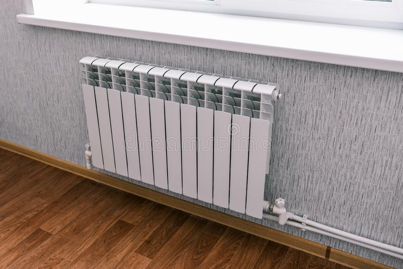Modern radiator in the house or apartment. Household bimetallic batteries. Panel water radiator system in a residential. Modern radiator in the house or royalty free stock photography