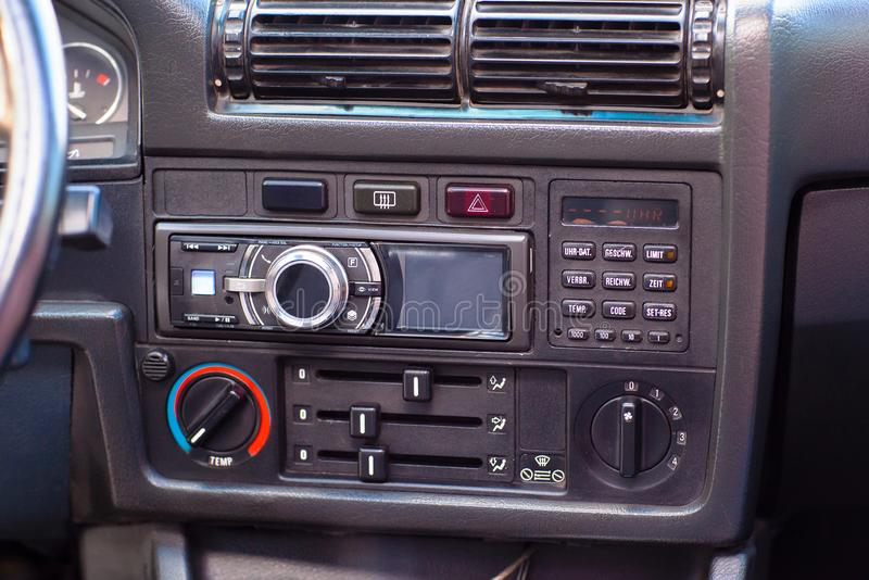 Modern radio in the interior of an old retro car royalty free stock images