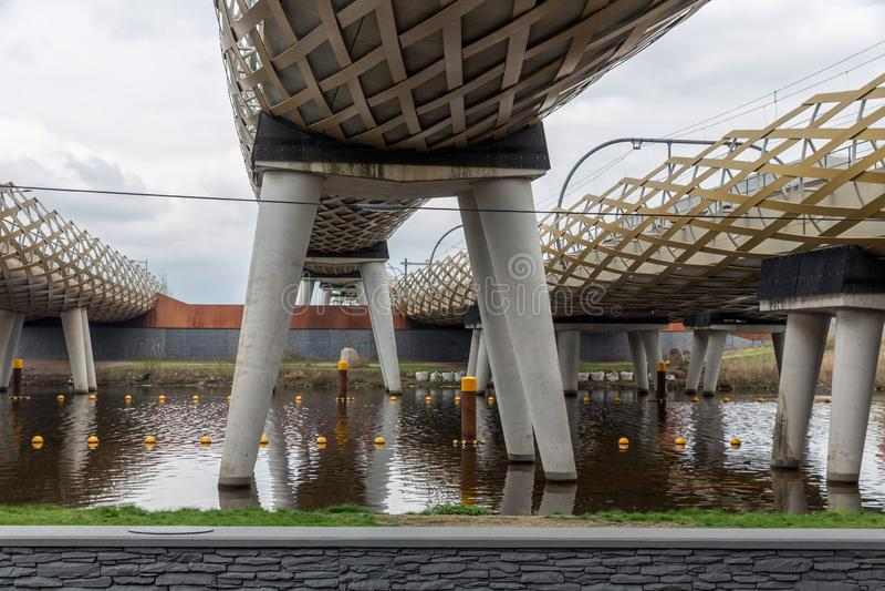 Modern railway bridge across river Dieze in Dutch city s-Hertogenbosch. Bottom of modern railway bridge across river Dieze in Dutch city Den Bosch stock photography