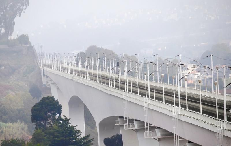 Modern railway bridge in Porto, Portugal. At foggy morning stock photography