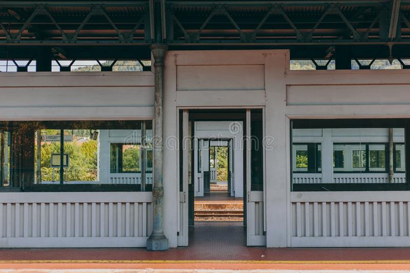 Modern railway station in sunny weather. Modern equipped railway station in sunny weather. Windows, doors, rails, reflections royalty free stock photos