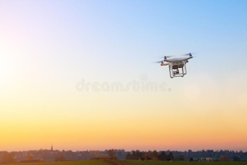 Modern RC UAV Drone / Quadcopter with camera flying on a clear s stock image
