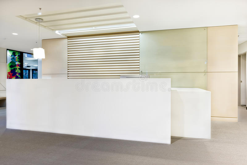 Modern reception office or building with lights on. And white walls royalty free stock images