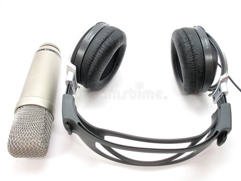 Modern recording gear. A modern set of recording headphones and microphone. Ready for the next vocal or voice over session royalty free stock image