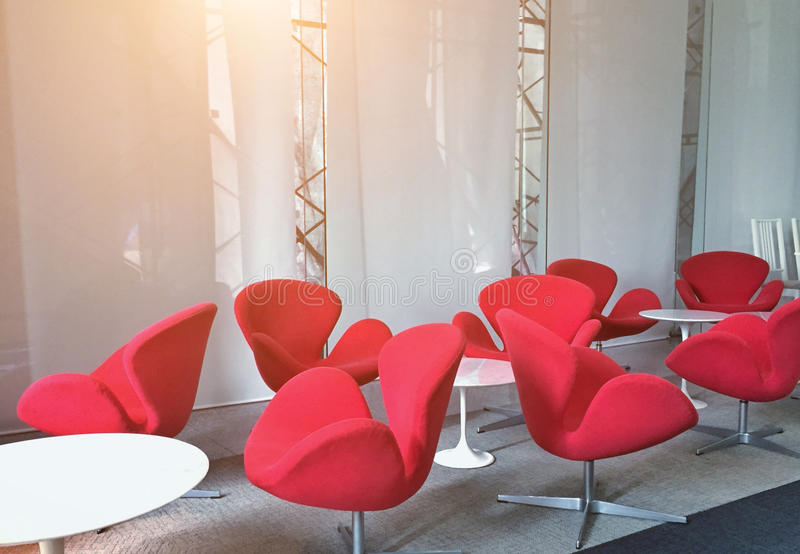 Modern red chairs in the meeting room for listening sessions royalty free stock image