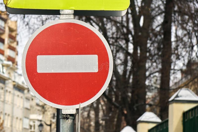 Modern red do not enter road sign with a reflecting surface in Moscow. Modern red do not enter road sign with a reflecting surface on the Moscow street royalty free stock image