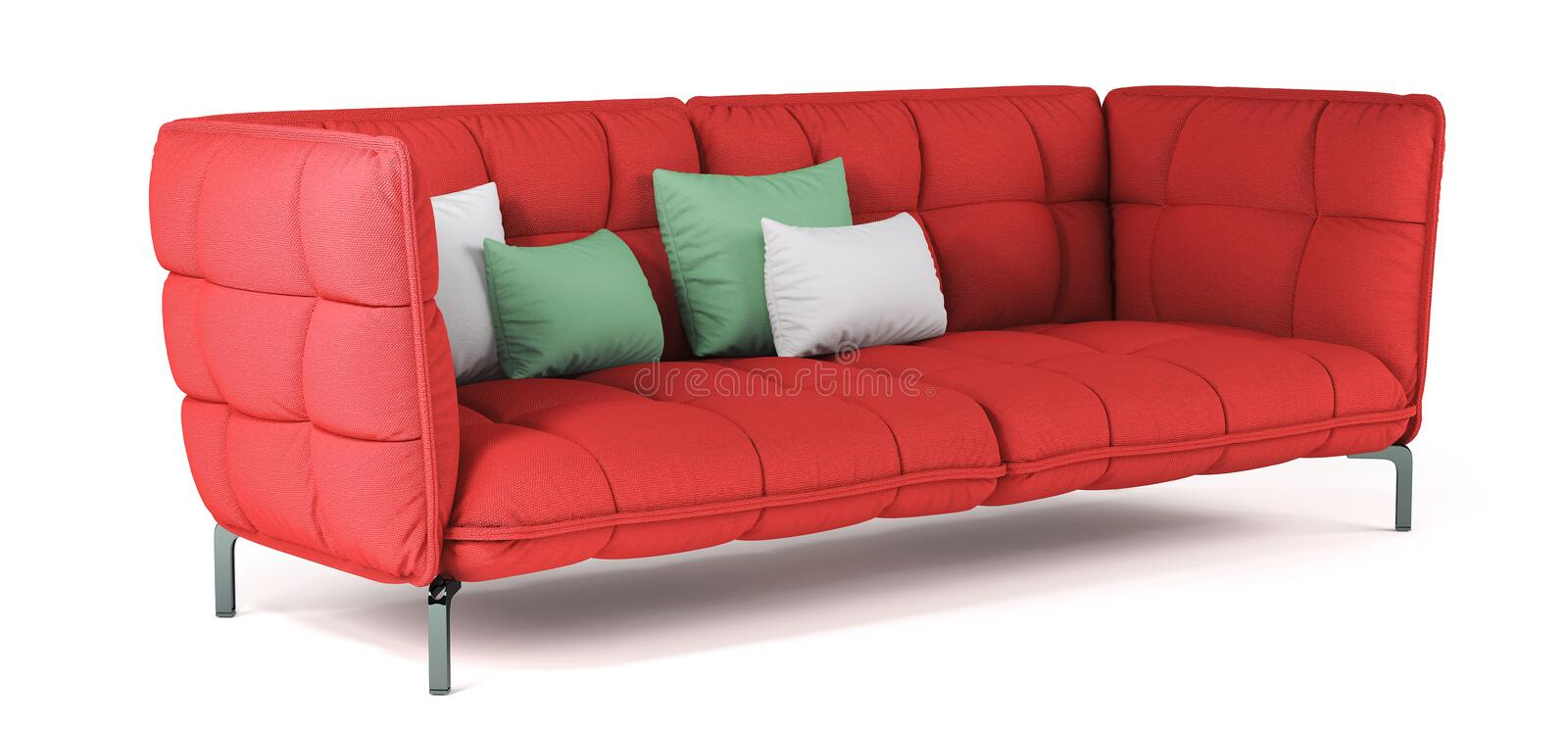 Modern red quilted fabric sofa on metal legs with pillows on isolated white background. Furniture, interior object. Bright scarlet stock photo