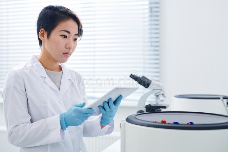 Modern researcher viewing results on tablet royalty free stock photography