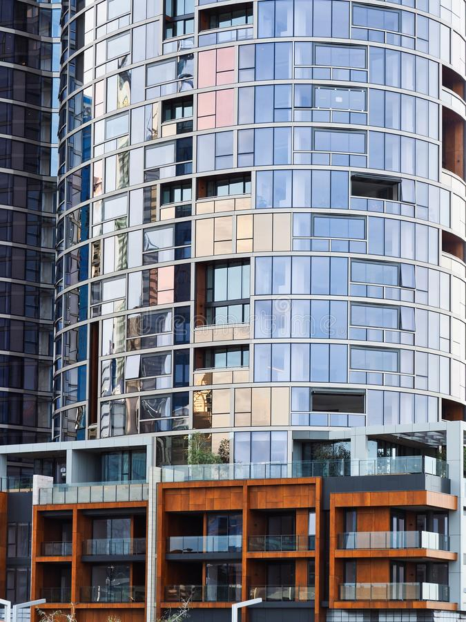 Modern Residential Apartment Tower, Perth, Western Australia. A modern residential apartment or condominium tall tower with glazed round or convex facade, Perth royalty free stock images
