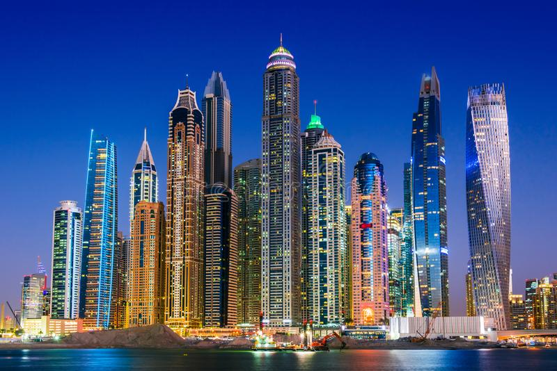 Modern residential architecture of Dubai Marina, UAE. Modern residential architecture of Dubai Marina, United Arab Emirates. City skyline by night royalty free stock photos