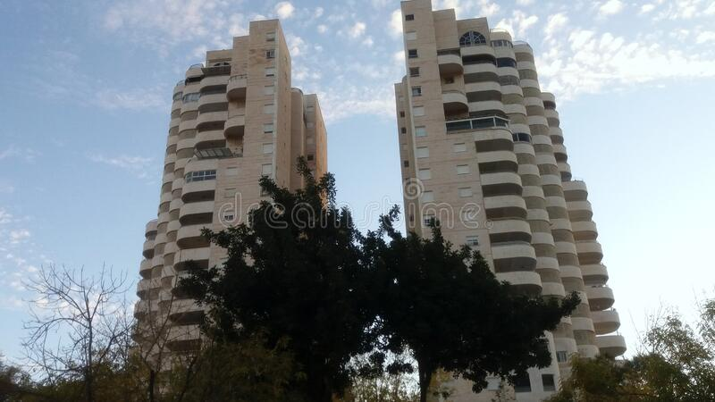 Modern residential building. City Modiin. Israel. People call it the Tower of David. In the early morning it is lit by the rays of the sun and becomes a golden royalty free stock photo
