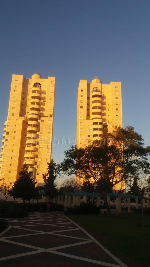 Modern residential building. City Modiin. Israel. People call it the Tower of David. In the early morning it is lit by the rays of the sun and becomes a golden royalty free stock photography