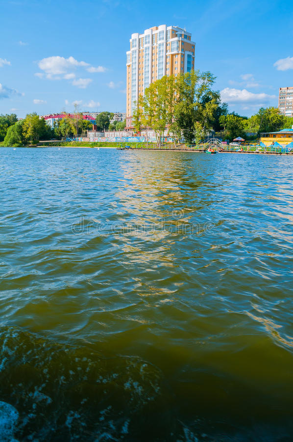 Modern residential building on the embankment of Iset river in Yekaterinburg in summer sunny day, Russia stock photography