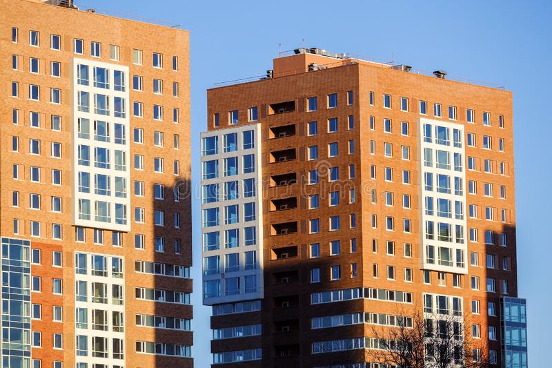 Modern residential buildings.Background of the Windows of modern residential skyscrapers royalty free stock photos