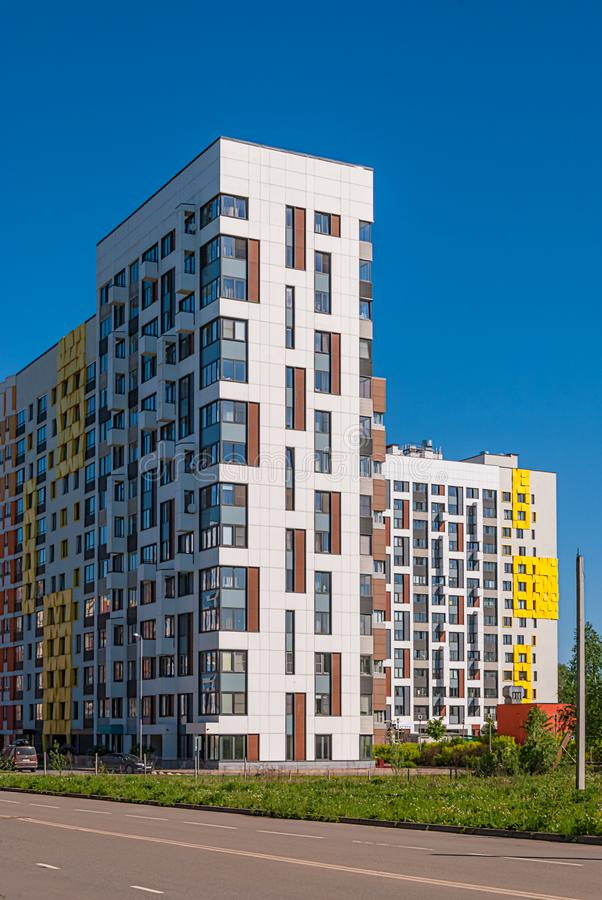Modern residential complex on the background of the blue sky. It houses variable height from 7 to 14 storeys, built in recent year stock images