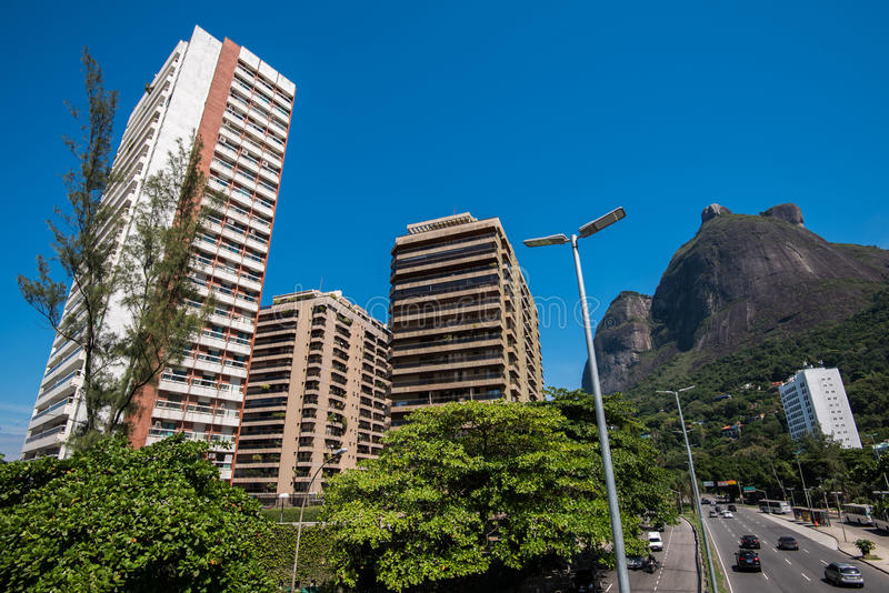 Modern Residential Condominium Buildings and Big Mountain Behind stock photography