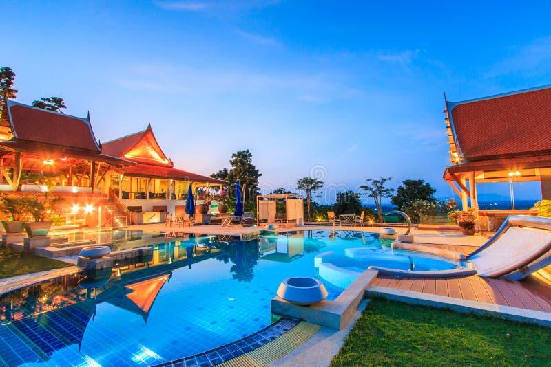 Modern resort. With swimming pool at night royalty free stock image