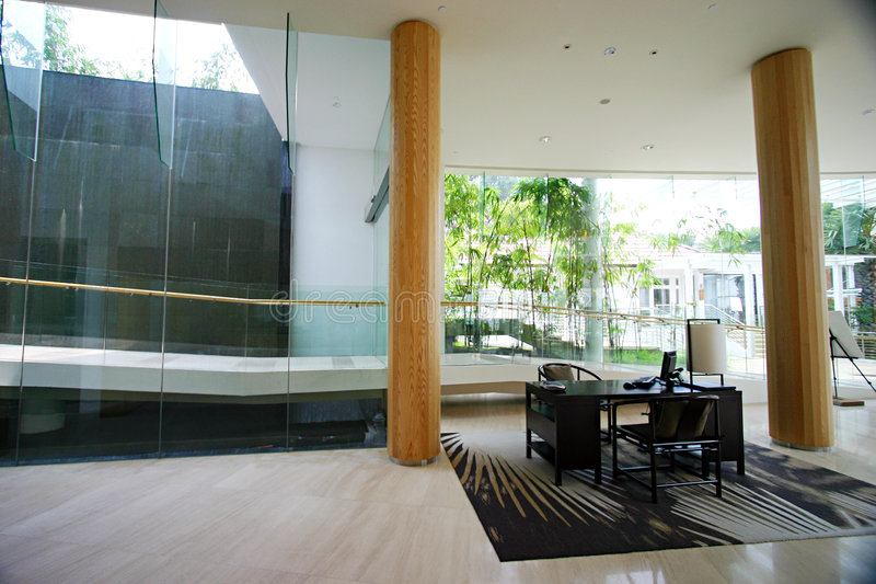 Modern resort interior. The beautifully furnished interior of a modern contemporary resort, with glass, wood and steel used in combination. Reception lobby with stock photo