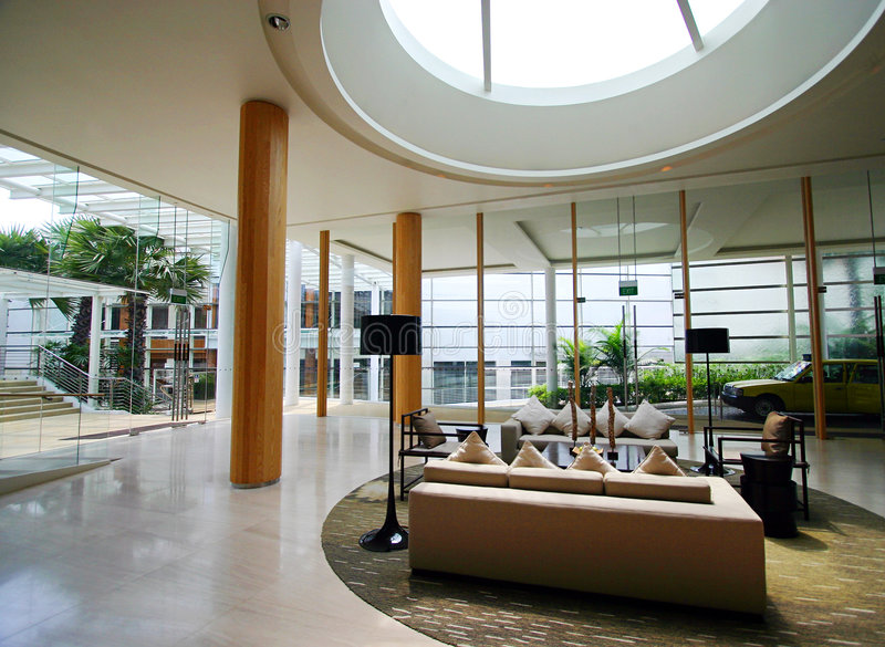 Modern resort interior. The beautifully furnished interior of a modern contemporary resort foyer, with glass, wood and steel used in combination for a cool airy royalty free stock image