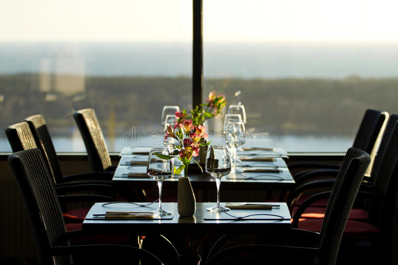 Modern restaurant interior. With scenic seaside view stock image