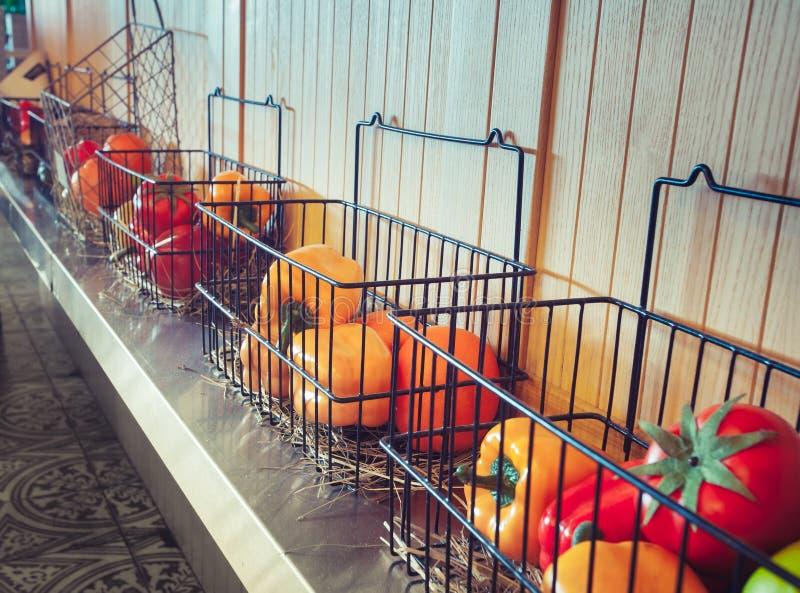 Modern restaurant Interior design. Plastic vegetables in boxes. Modern restaurant Interior design stock image