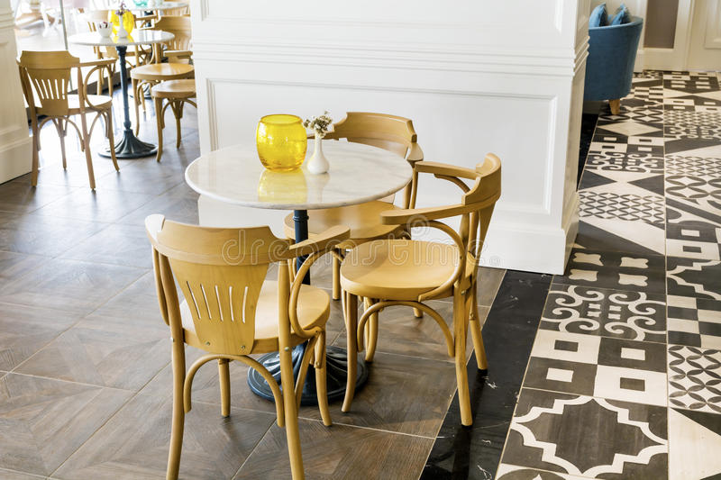 Modern restaurant interior. Italian cozy restaurant with modern tables and chairs royalty free stock image