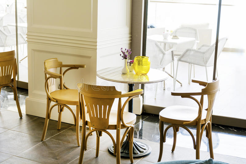 Modern restaurant interior. Italian cozy restaurant with modern tables and chairs stock image