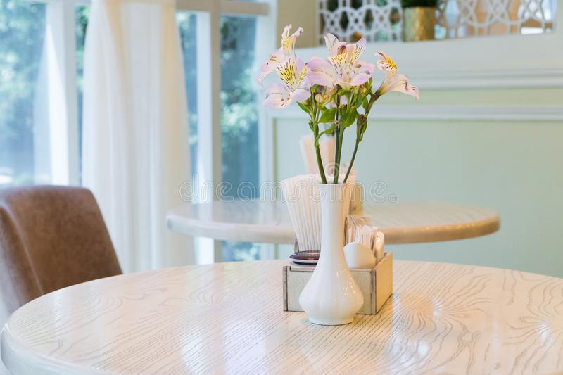 Interior of the cafe. Modern restaurant interior with windows and flowers. cafe room illuminated by sunlight stock images