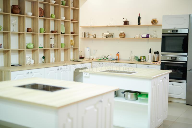 Modern Restaurant Kitchen. Background shot of interior in modern restaurant kitchen with stoves and equipment, copy space royalty free stock images