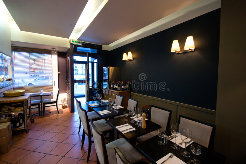 Modern Restaurant's interior. Interior of a modern restaurant with ambient light. Tripod mount and mirror lock up used to ensure maximum sharpness royalty free stock image