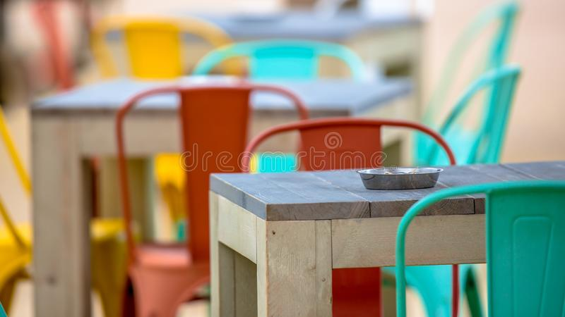 Modern Restaurant terrace with ashtray. Modern Restaurant terrace outdoor with ashtray in fancy colors royalty free stock photos