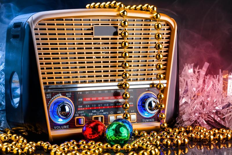 Radio receiver in retro style with christmas decorations on black background stock photos