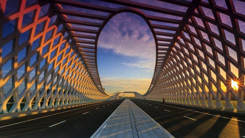 Modern road bridge at sunset stock photo