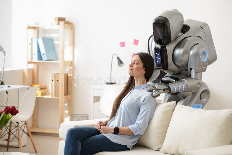 Modern robot making a massage stock image