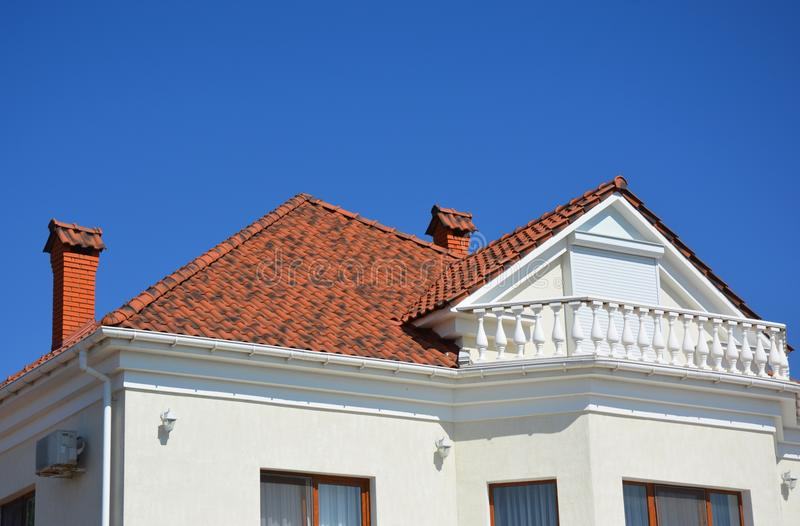 Luxury roofing constraction with natural clay roof tiles, house attic balcony and metal shutters, blinds. Modern roofing constraction with natural clay roof stock photos