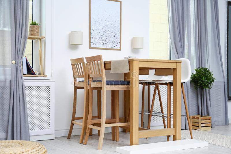 Modern room interior with wooden table stock photos