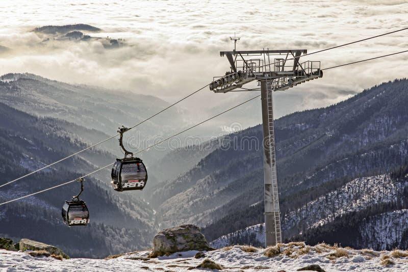 Modern ropeway at hill Chopok - Low Tatras mountains , Slovakia. DEMANOVSKA DOLINA, SLOVAKIA - DECEMBER 17:  Cabins of cableway in ski resort Jasna - Low Tatras stock photo
