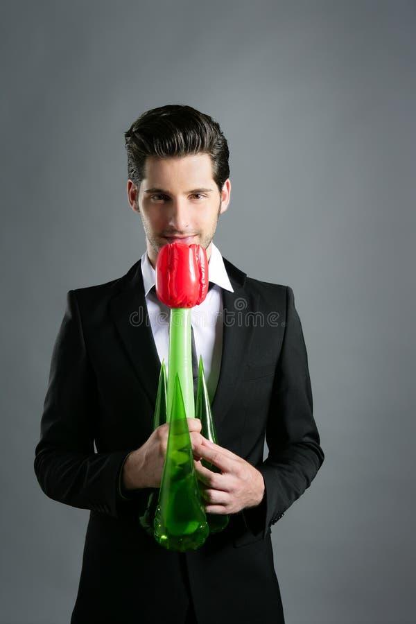 modern rose valentin för affärsmanblommahand arkivbilder