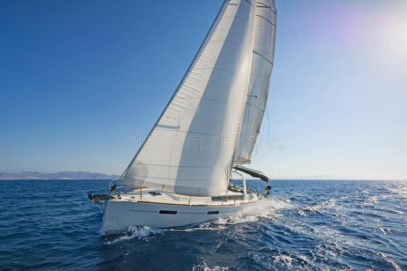 Modern sailing yacht in action stock photo