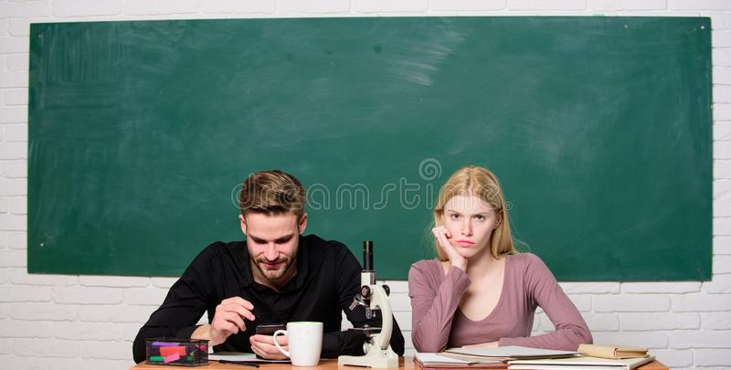 Modern school. Knowledge day. Back to school. Couple of man and woman in classroom. Student life. Lesson and blackboard. Modern school. Knowledge day. Back to royalty free stock photography