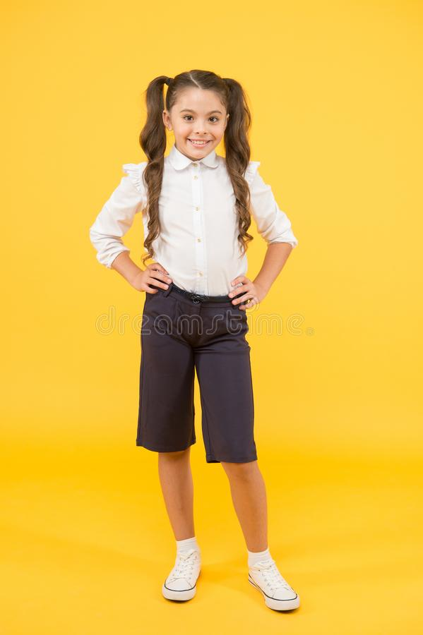 Modern schoolgirl. Schoolgirl happy smiling pupil long hair. Beginning of academic year. Adorable schoolgirl. Time to stock image