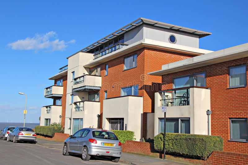 Modern seaside apartments. Photo of a newly built modern apartments by the sea in the town of whitstable in kent stock photo