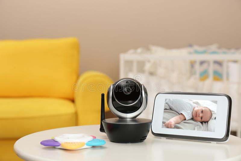 Modern security CCTV camera and monitor with baby`s image on table royalty free stock image