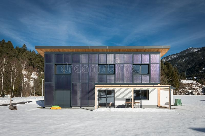 Modern self-sufficient house with sun panels. For heating stock photography